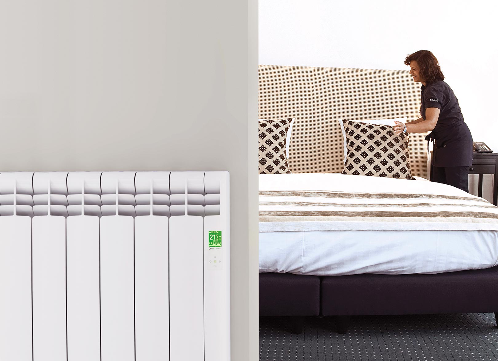 Rointe D Series WiFi electric radiator in a hotel bedroom