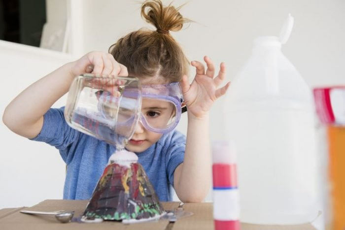 Young girl with science googles conducting fun science experiments