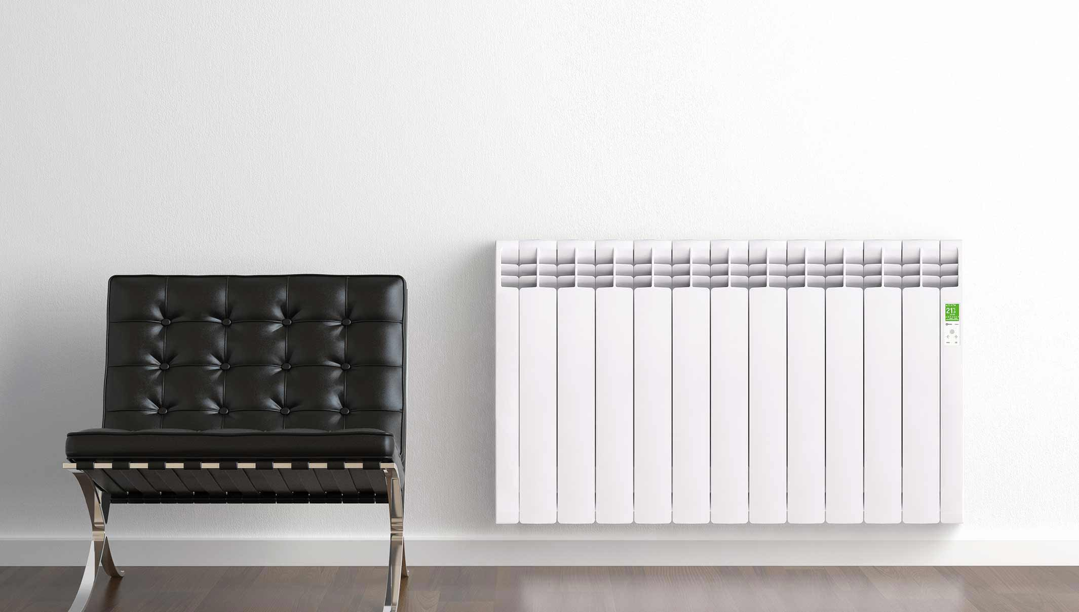 Rointe D Series white electric radiator in hallway next to a leather chair