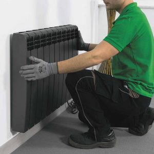 Rointe installer mounting Rointe electric radiator to wall