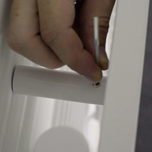 Step 7: tightening the screws to the wall for a Rointe towel rail
